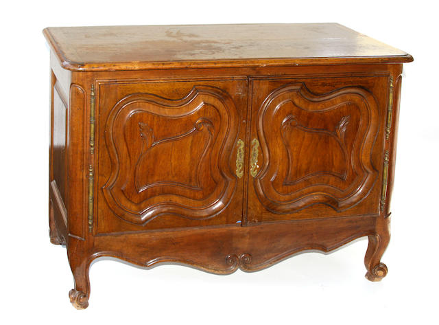 A Louis XV style mixed wood commode