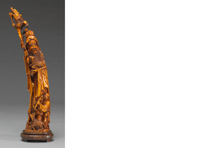 A Chinese tinted and carved ivory figure of Su Wu