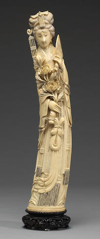 A Chinese carved ivory figure of an empress