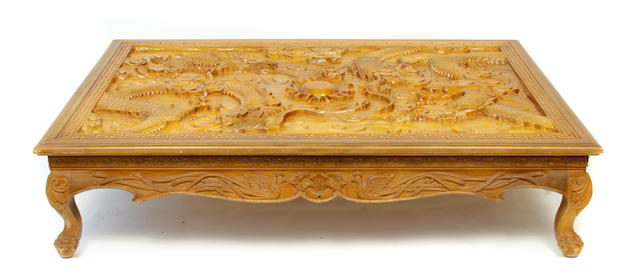 An Asian carved wood low coffee table