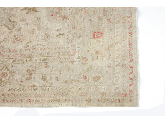 An Oushak carpet size approximately 10ft 10in x 14ft 9in
