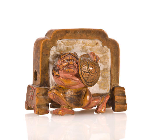 Wood netsuke of a tsuitate with Shoki and oni, by Shuzan