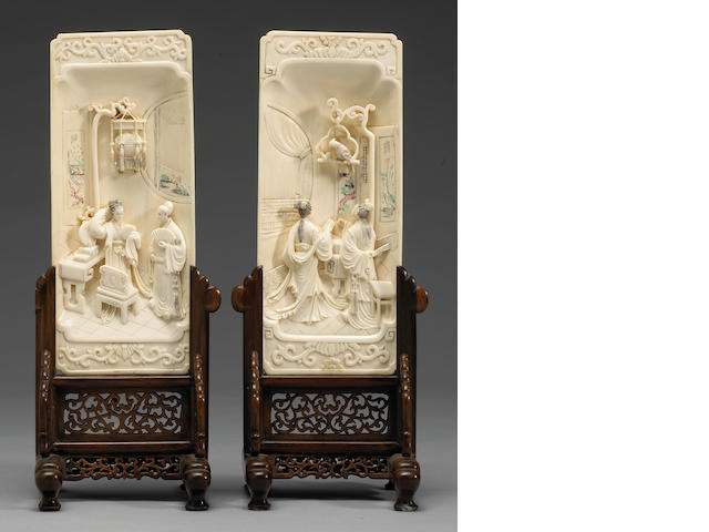 A pair of Chinese carved ivory rectangular panels with wood stands for use as table screens 20th Century