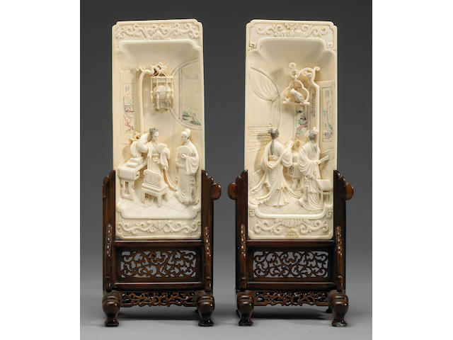 A pair of carved ivory rectangular panels 20th century