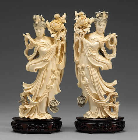 A pair of large Chinese ivory figures of celestial maidens, holding peonies, mid 20th century