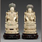 Pair of Chinese tinted ivory seated emperor and empress figures with colored inlay, 20th century