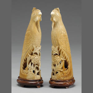Pair of Chinese carved ivory parrots on stands