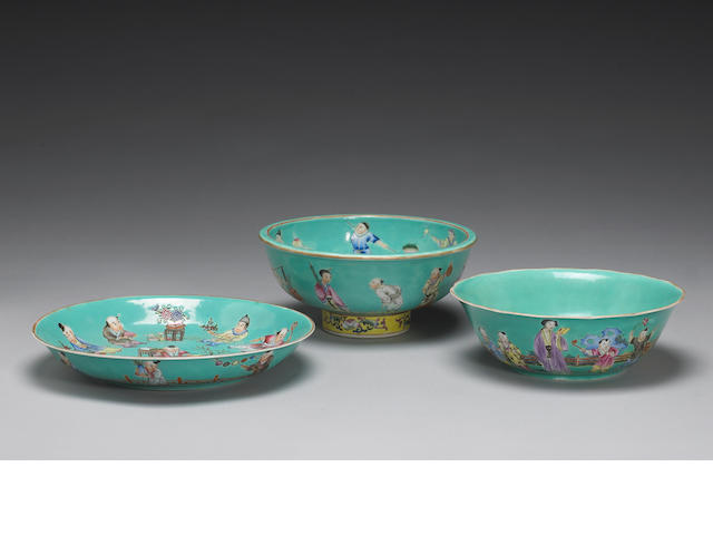 A group of three Chinese turqoise ground famille rose porceline dishes, one bowl, one footed bowl, and one dish (two with Jiaqing marks, one with a spunous Jiaqing mark) Provence: Marchall fields