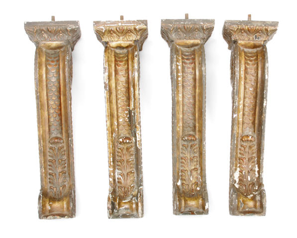 A set of four Baroque style iron and gesso architecural elements