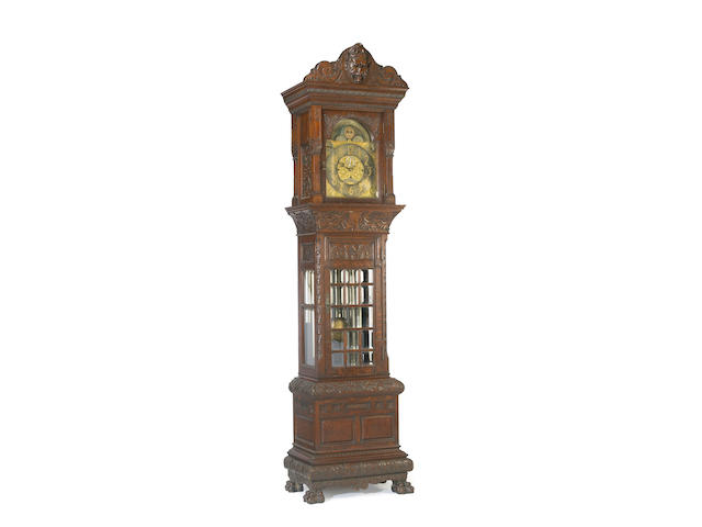 An American carved oak glass door tall case clock <br>last quarter 19th century