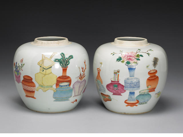 A pair of famille rose porcelain ginger jars and wood covers