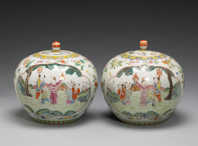 A pair of famille rose globular jars and cover with figural decoration
