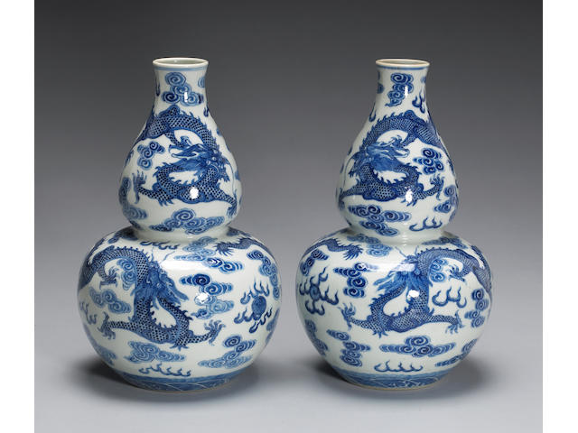 A pair of blue and white double gourd porcelain vases, with dragon and cloud design, Qianlong mark, Republic Period