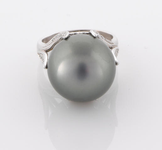 A black South Sea cultured pearl and diamond ring