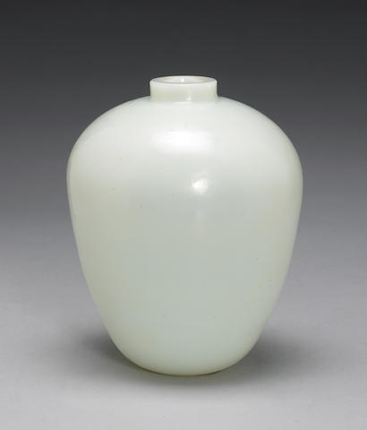 A small glass simulated white jade ovood vase with a carved wood cover