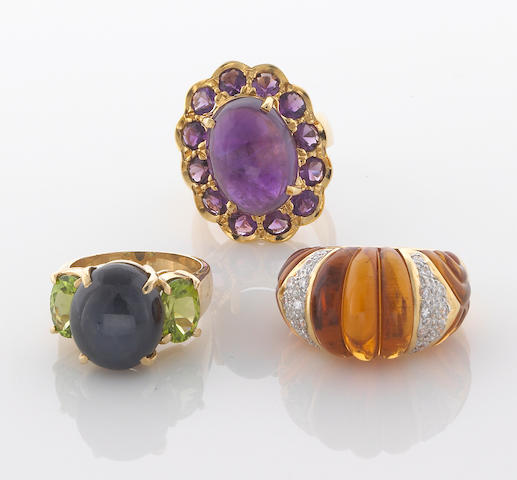 A group of 3 citrine ame, peridot, sapphire and diamond rings in 14K (2) and 18k (1), 34.9g