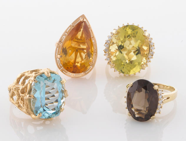 A group of 4 gem-set and diamond rings in 14K