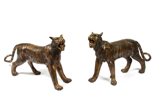 A pair of patinated bronze models of tigers