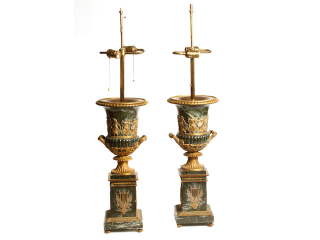A pair of Continental Neoclassical style gilt bronze mounted marble table lamps