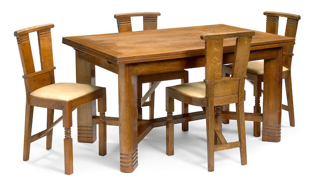 A Charles Dudouyt oak dining suite 1930s
