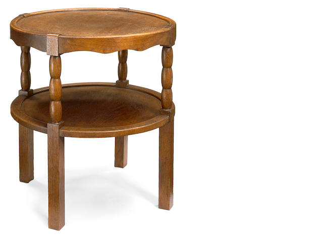 A Charles Dudouyt oak two tier side table