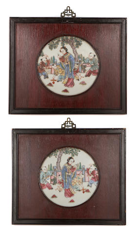 A pair of Chinese famille rose procelain wall plaques paint decorated with a maiden and boys