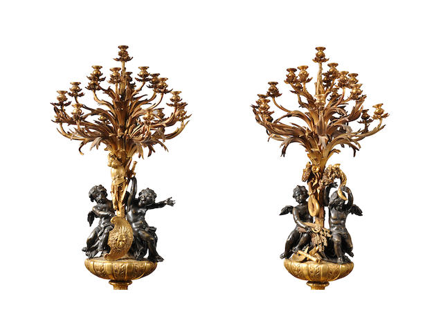 """A magnificent and monumental pair of Louis XVI style gilt and patinated bronze figural nineteen light candelabra emblematic of """"War"""" and """"Peace""""  Louis-Auguste Alfred Beurdeley (1808-1883) Paris, circa 1860"""