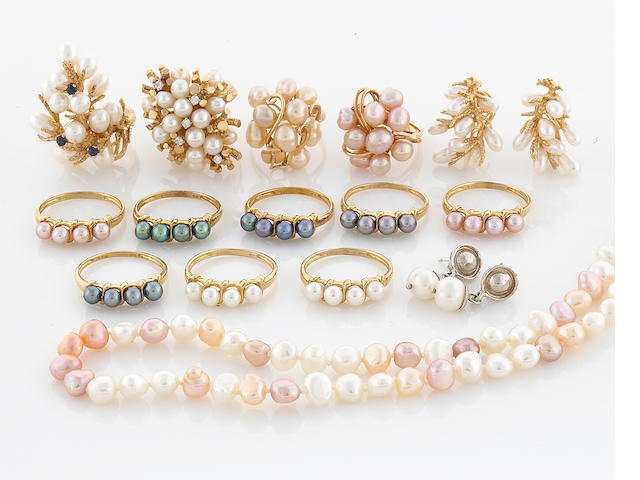A group of 15 pieces pearl jewelry including 8= 10K rings 1 earring in silver 1 earring in gold, 4 rings in 14K, necklace