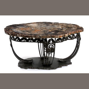 An Art Deco style wrought iron and petrified wood coffee table
