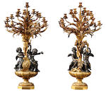 A magnificent and monumental pair of Louis XVI style gilt and patinated bronze figural nineteen light candelabra <br>Louis-Auguste-Alfred Beurdeley (1808-1882)<br>fourth quarter 19th century