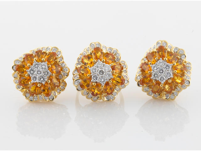 A  yellow sapphire, diamond, and 18k gold ring together with a pair of earrings
