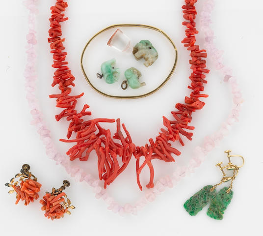 A collection of coral, jade, rose quartz, glass, 14k gold, silver and metal jewelry