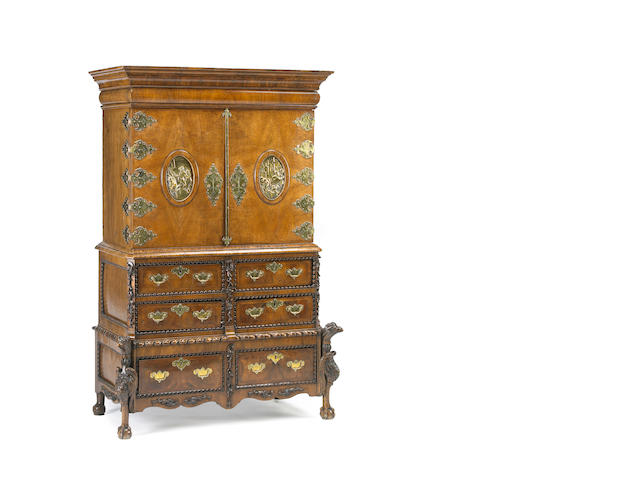 A Continental Baroque walnut and cross banded cabinet on chest on chest, late 17/early 18th century