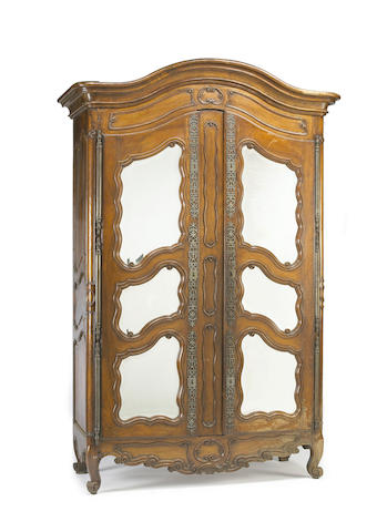A Louis XV walnut mirrored armoire 18th century