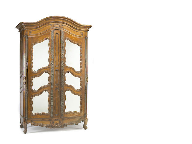 A Louis XV walnut mirrored armoire 18th century