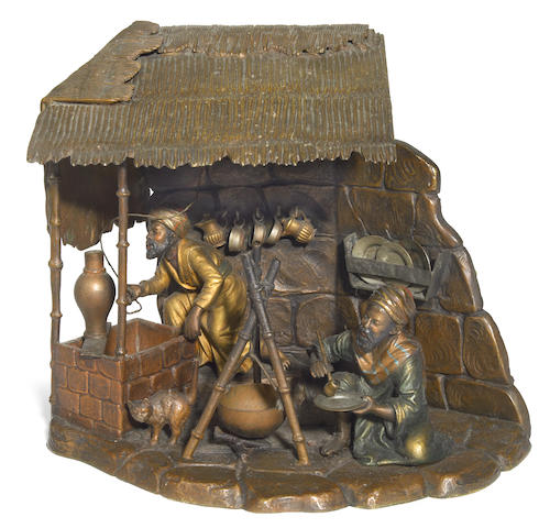 An Austrian cold painted bronze Coffee Vendors figural lamp  circa 1900