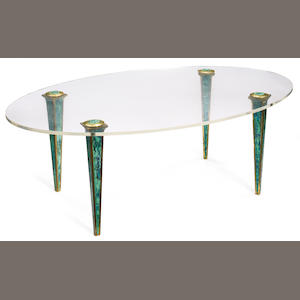 A William Haines patinated metal and lucite oval coffee table circa 1956