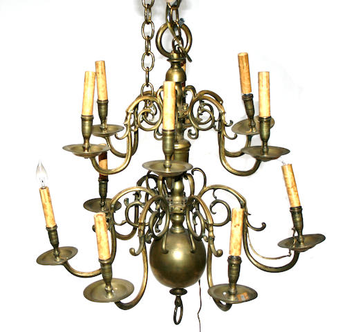 A Dutch Baroque style two tier brass twelve light chandelier  19th century