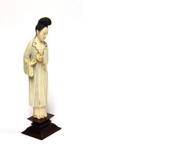 A Chinese carved ivory maiden, light polychrome details, circa 1900