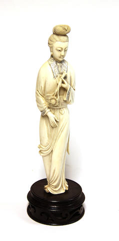 A carved ivory standing beauty 20th century