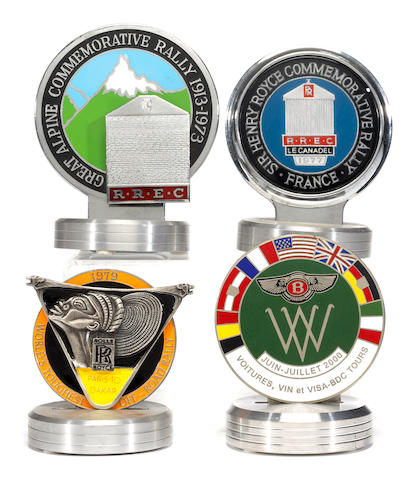 A collection of four European Rolls Royce rally badges,
