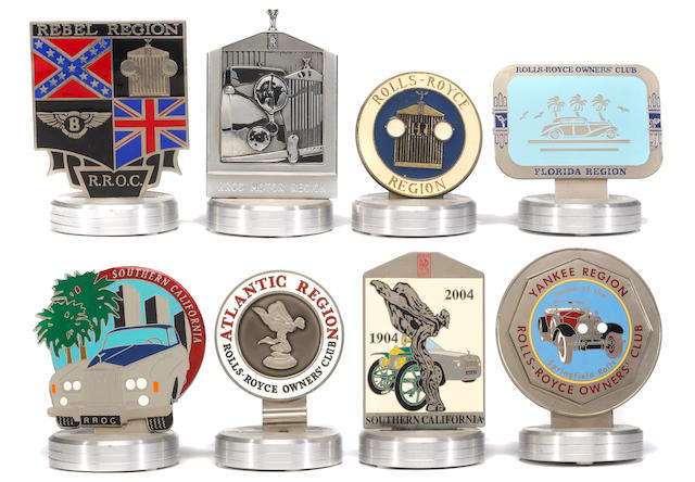An assortment of Rolls-Royce Owners Club regional badges,