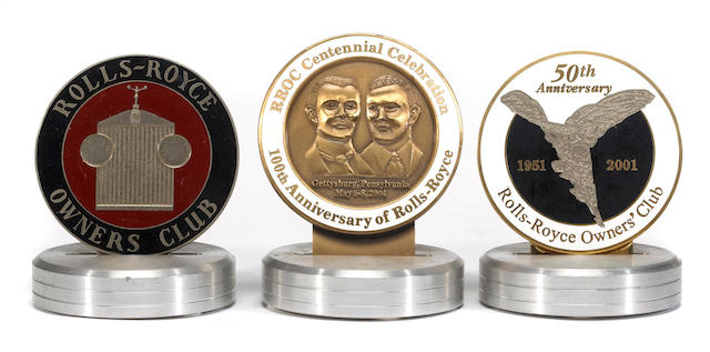 A pair of Rolls-Royce Owners Club anniversary badges,