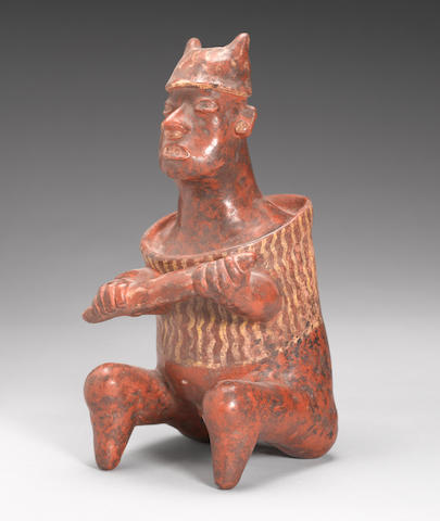 A Nayarit seated figure of a warrior