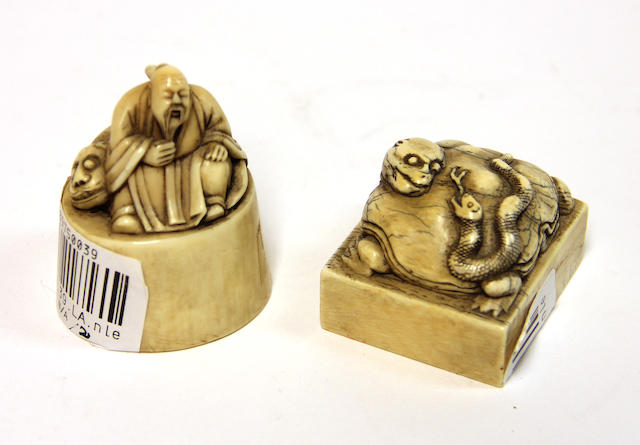 Two Chinese ivory seals, one with a seated Immortal and a recumbent tiger, the other with a snake and a mythical tortoise, fine quality, late 19th century