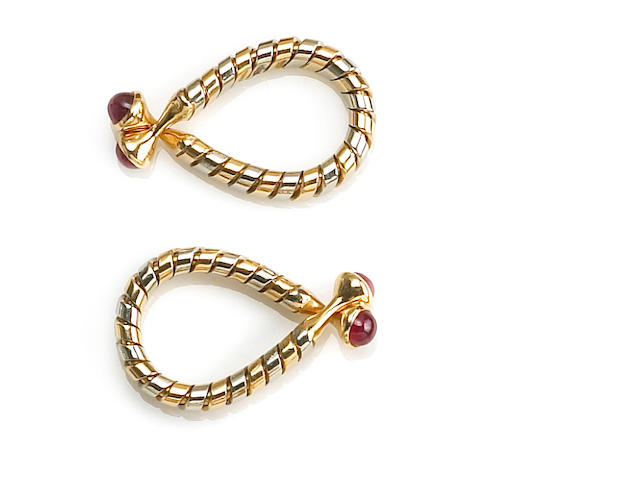 A pair of eighteen karat bicolor gold and ruby cufflinks, Bulgari