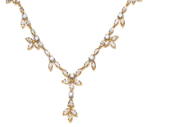 A colored diamond and diamond necklace