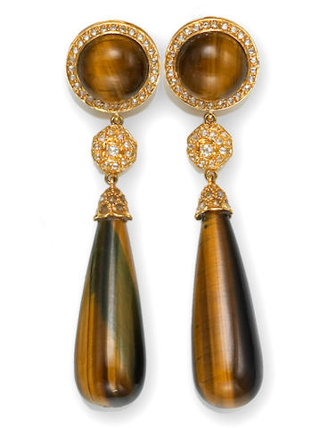 A pair of tiger's eye and diamond earrings