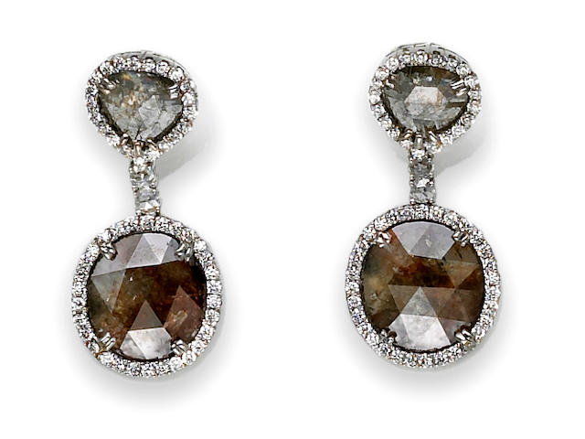 A pair of colored diamond and diamond pendant earrings
