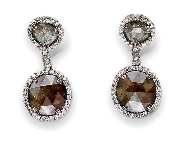 A pair of colored diamond and diamond pendant earrings